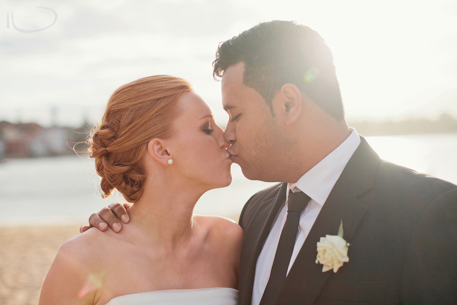 Romantic Wedding Photographers: Bride & Groom kissing at sunset