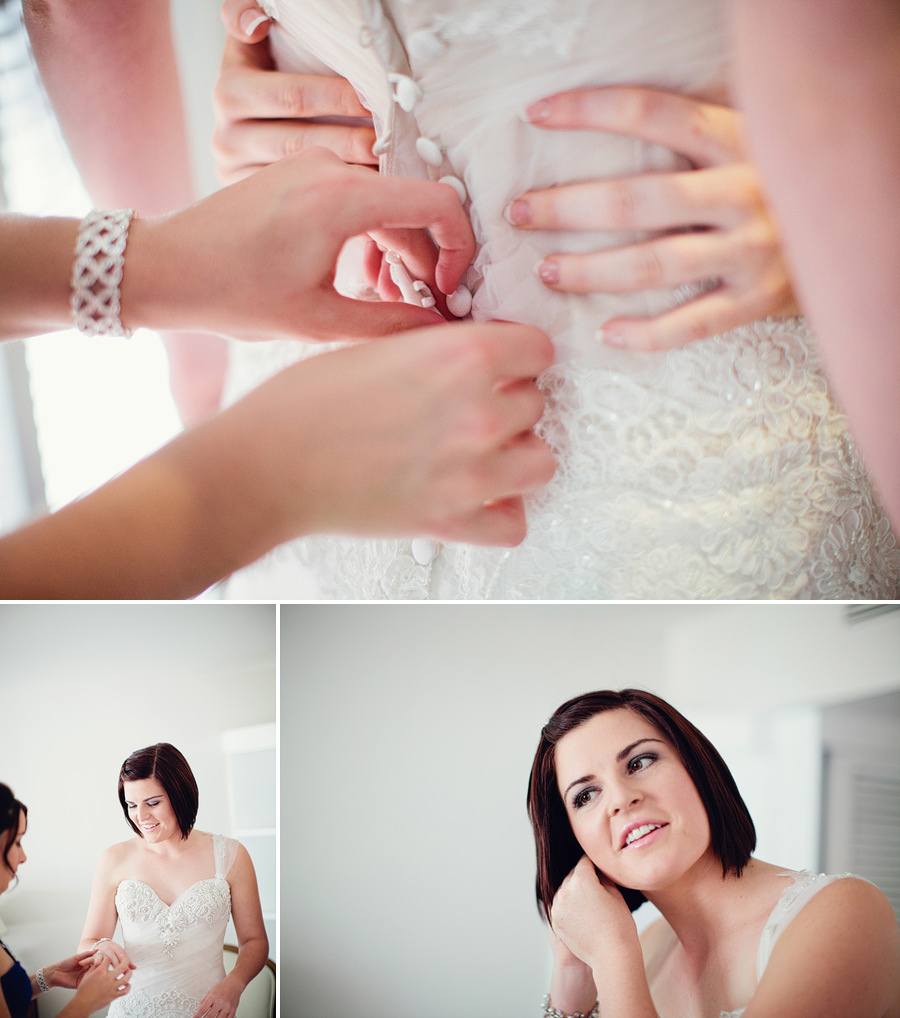 Coral Coast Wedding Photography: Bride putting jewellery on