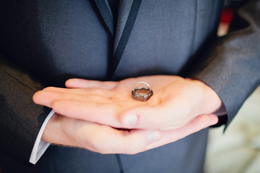 Pacific Harbour Wedding Photography: Groom holding wedding rings