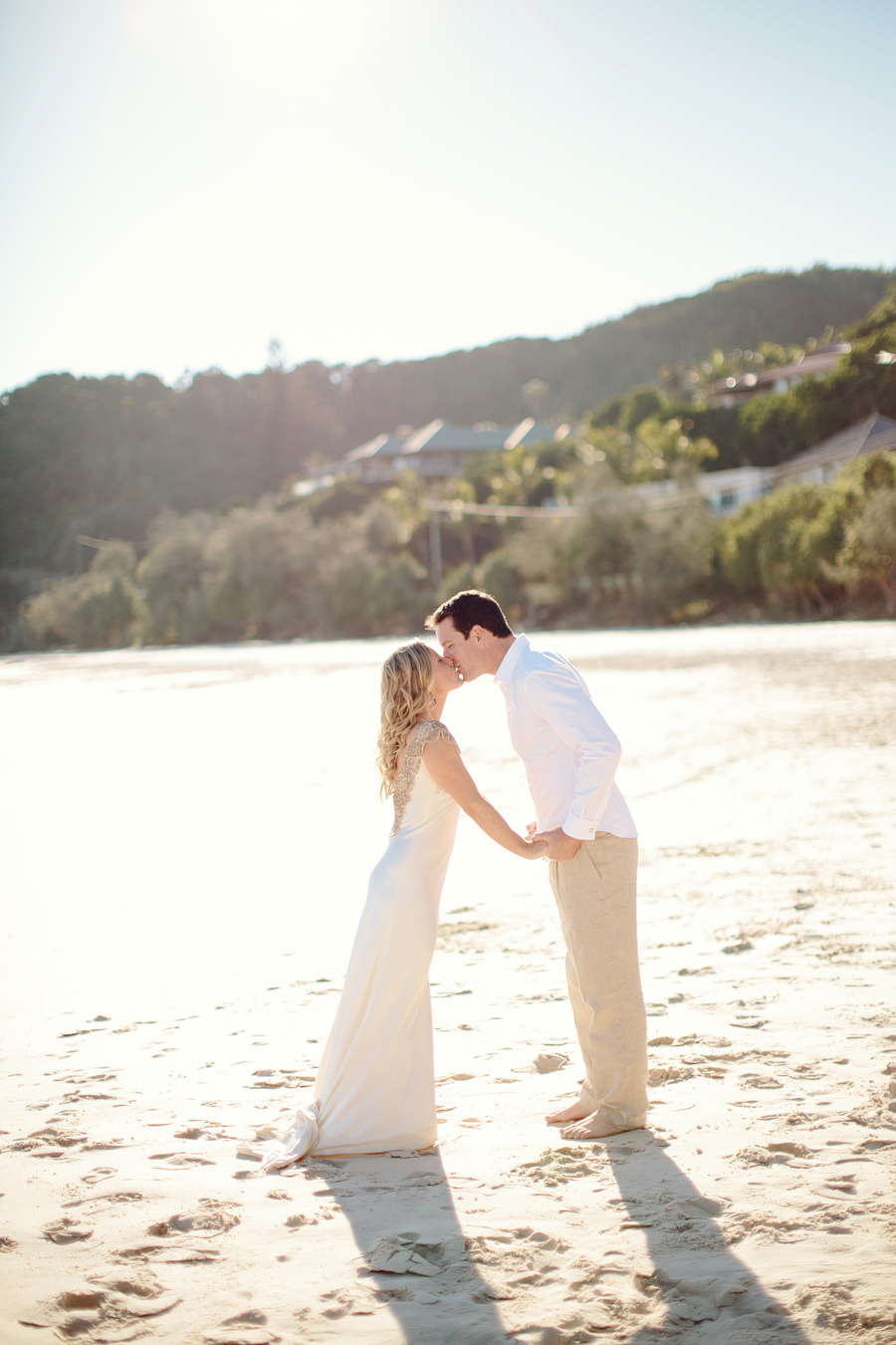 Fresh Wedding Photographer: Kissing on the beach