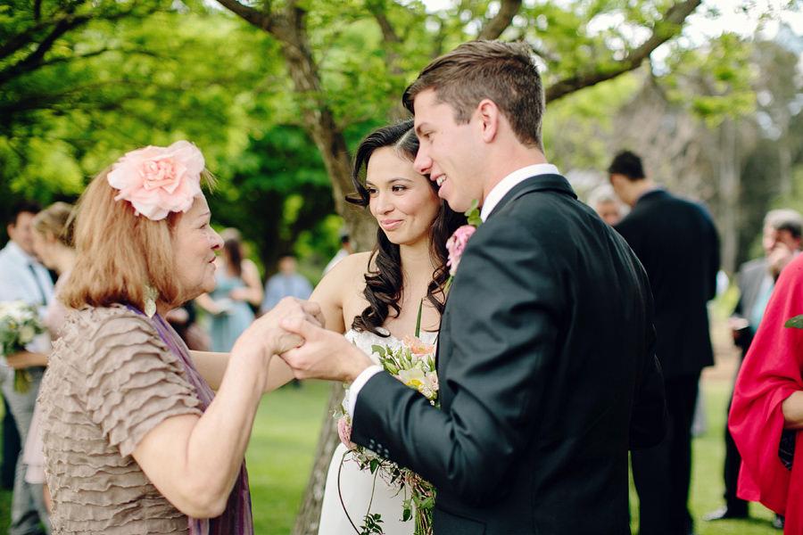 Photojournalistic Wedding Photography: Bride & Groom chatting with grandma
