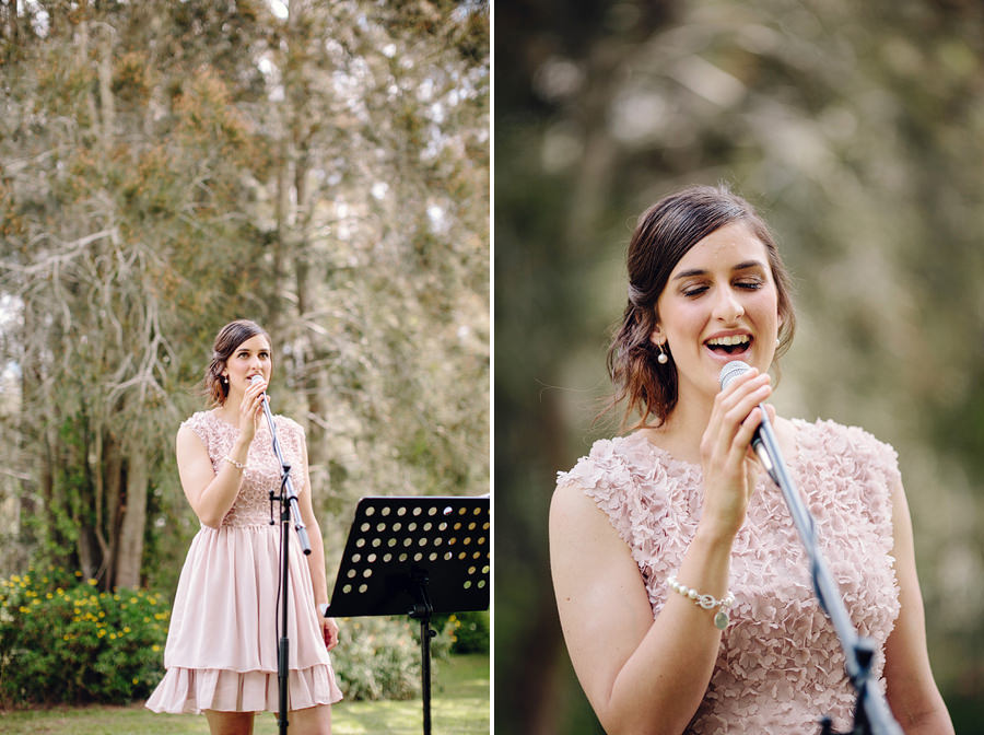 Timeless Wedding Photographers: Bridesmaid singing during ceremony