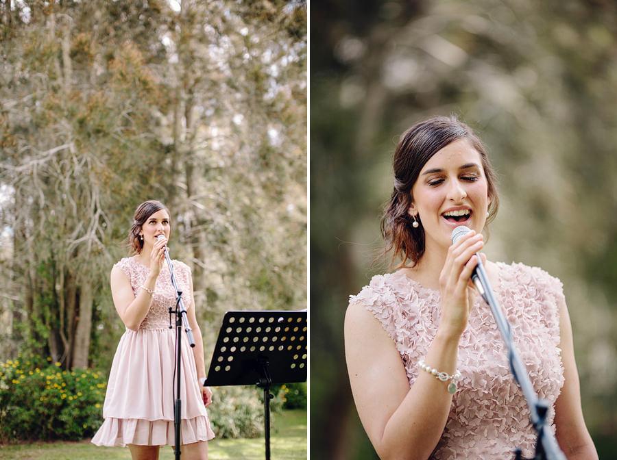 Timeless Wedding Photographers: Bridesmaid singing during ceremony