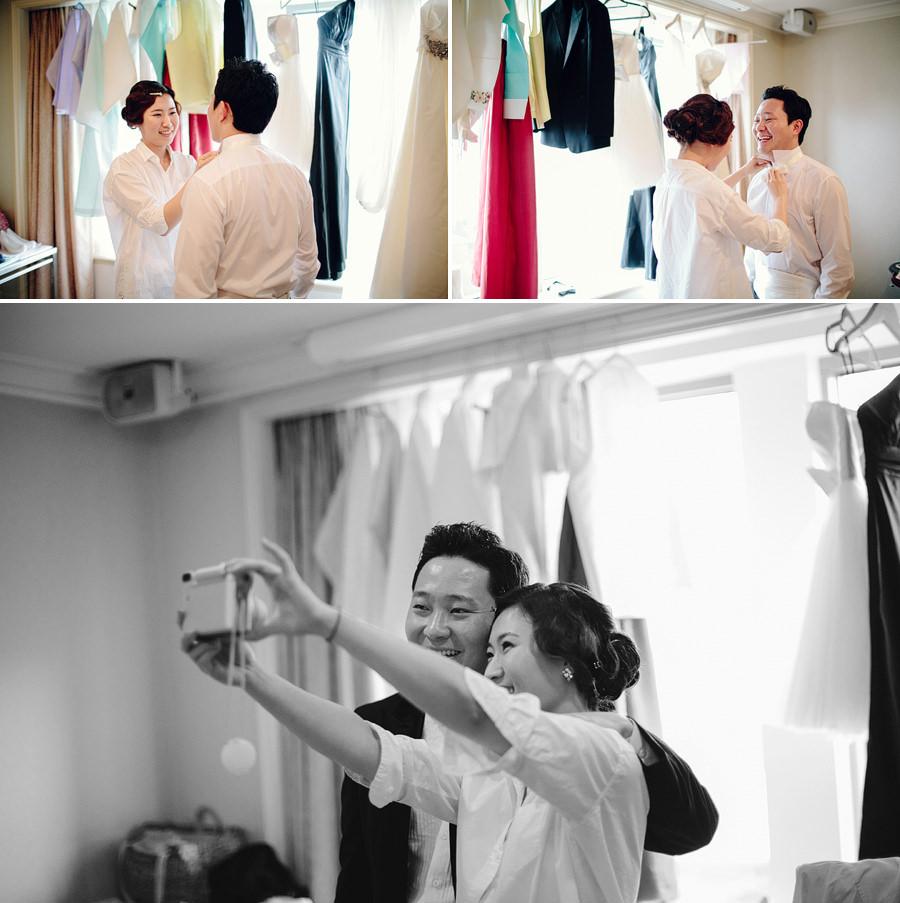 Shangrila Sydney Wedding Photographers: Bride dressing groom