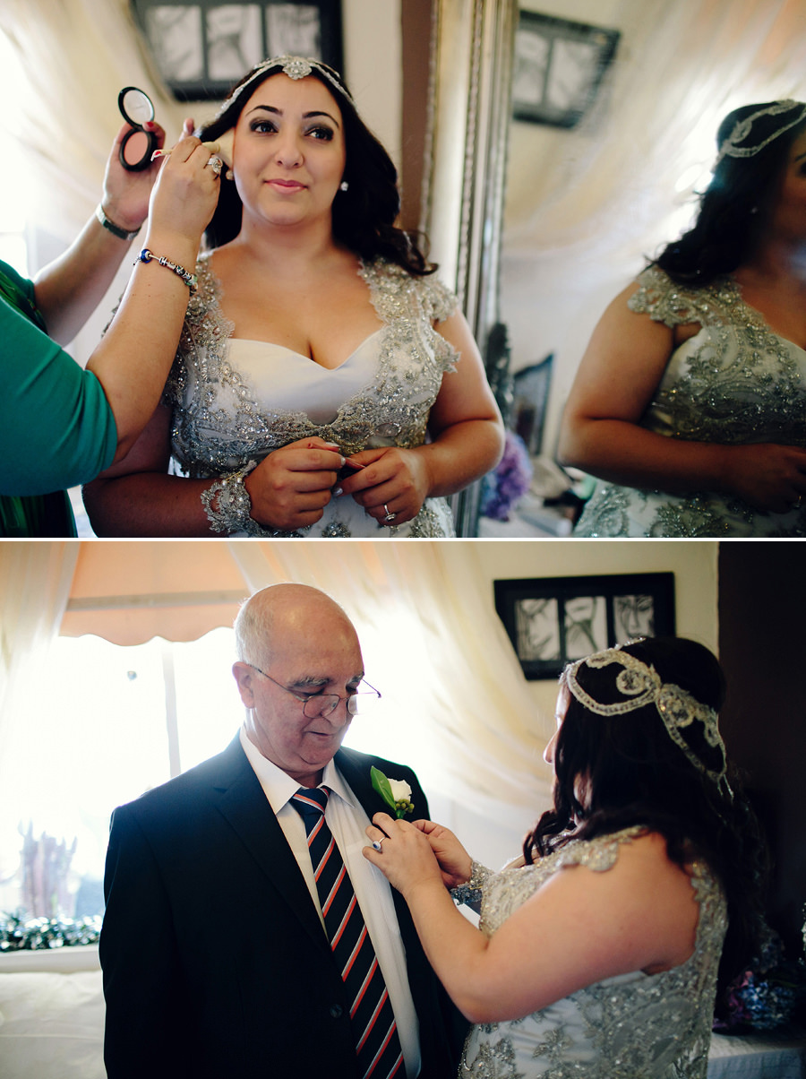 Greek Wedding Photography: Bride pinning boutonniere on father