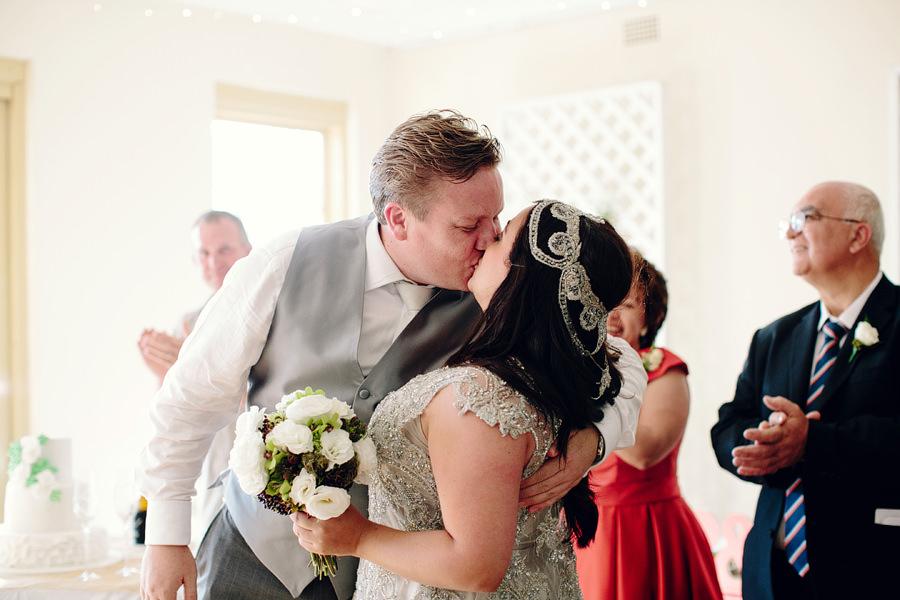 Modern Wedding Photographers: First kiss