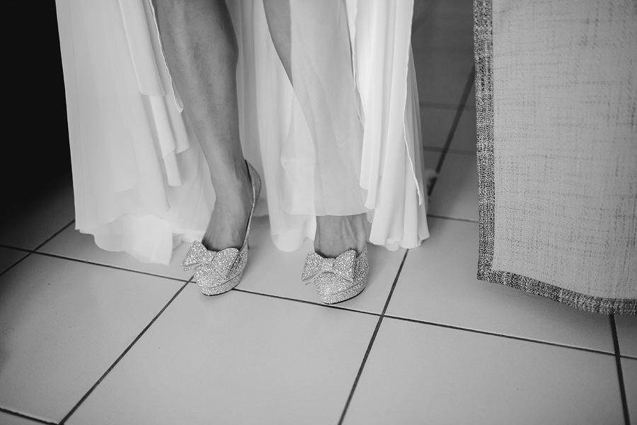 Contemporary Wedding Photographers: Bride putting on shoes