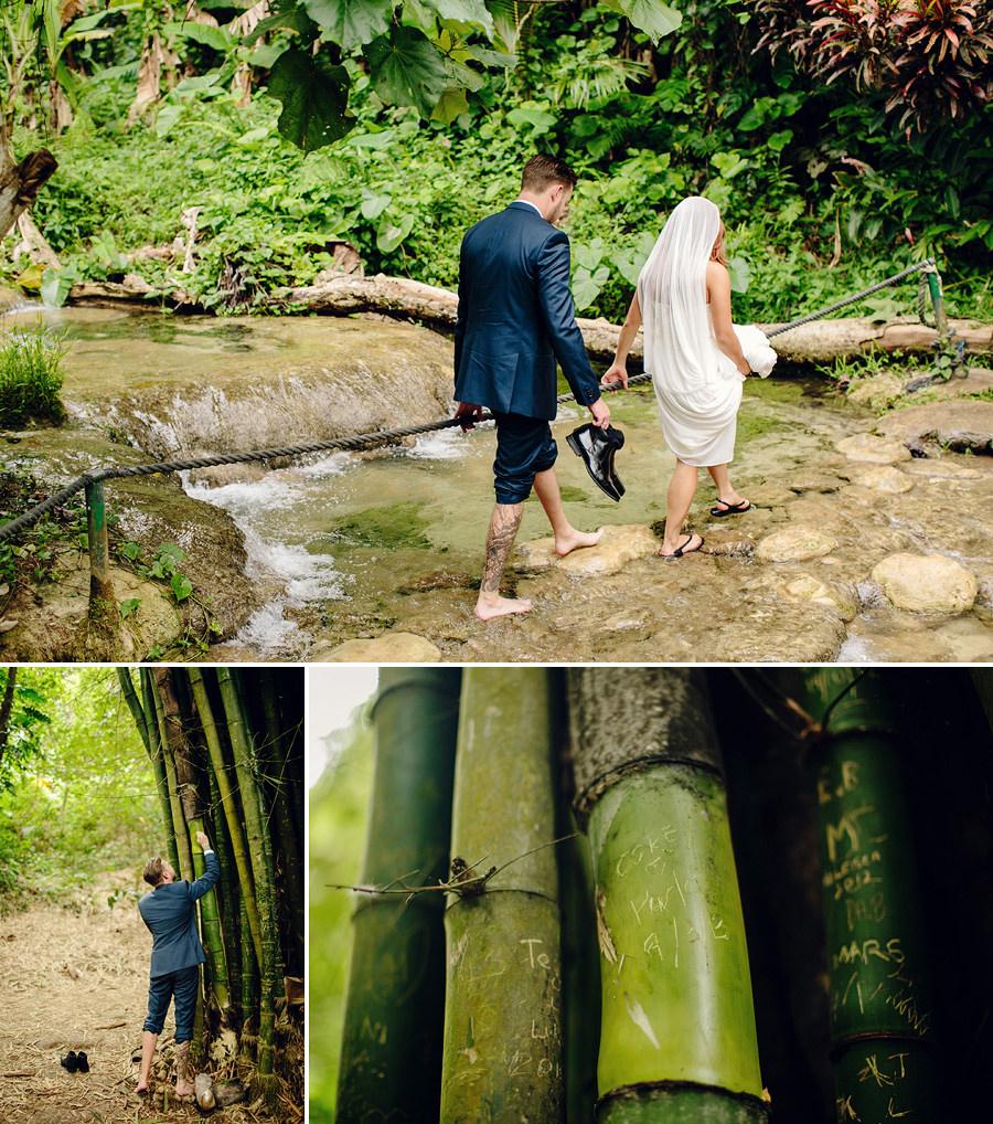 Mele Cascades Wedding Photography: Bride & Groom climbing waterfall