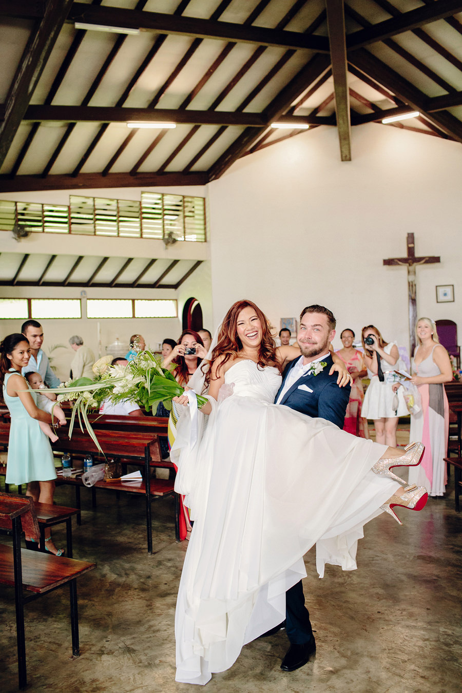 South Pacific Wedding Photographer: Bride carried down the aisle