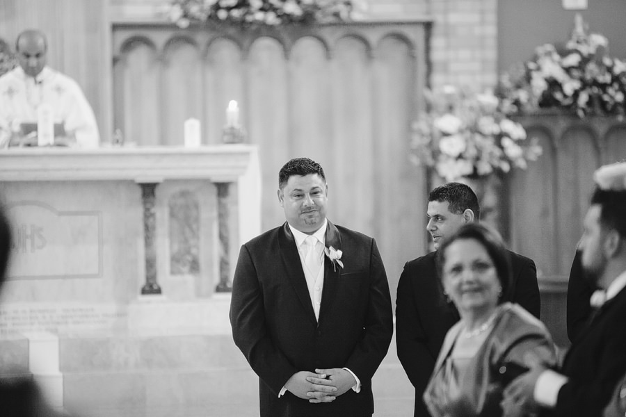 Catholic Wedding Photography: Groom waiting for bride
