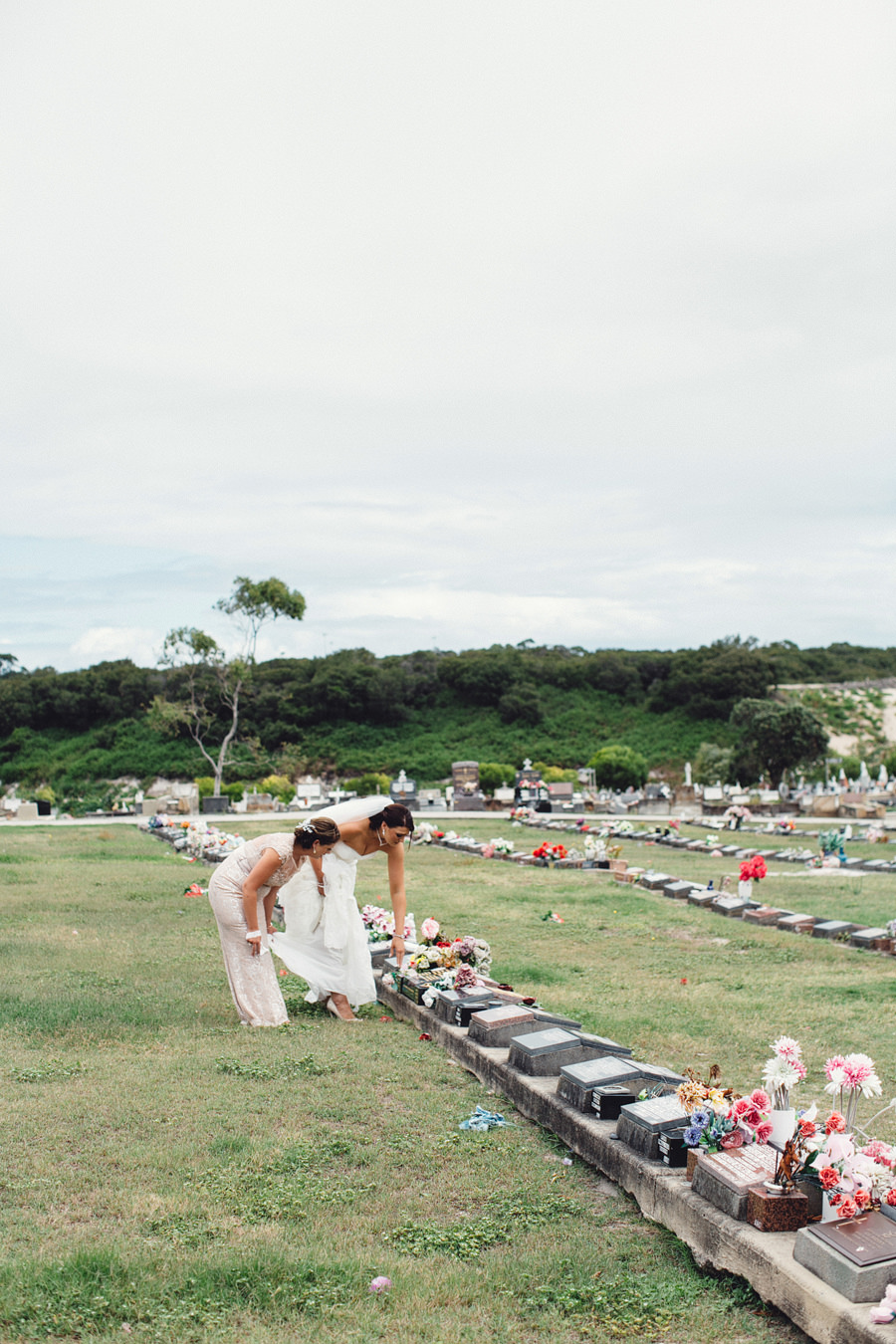 Documentary Wedding Photographer: Bride visiting cemetary